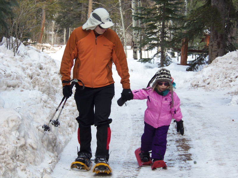Jason snowshoeing with daughter