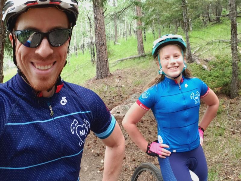 Jason and daughter mountain biking